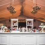 Medallion-Bar-and-Black-Chandeliers.-Photo-courtesy-of-Amber-Bridges-Studio.-Planned-by-Lindsey-Baer-Company.jpg